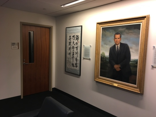 painting of Richard Nixon hung on the wall outside Atiba Ellis's research carrel